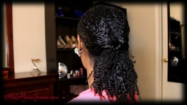 Simple ponytail with a twist on natural har